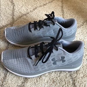 Grey Under Armour running shoes